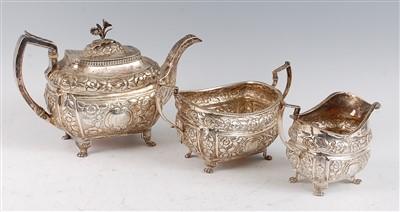 Lot 1080 - A late Georgian Irish silver three-piece tea...