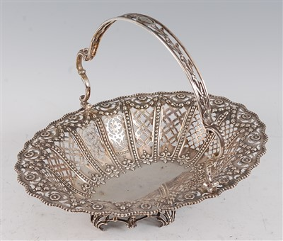 Lot 1085 - A George V silver basket, of pierced oval form...