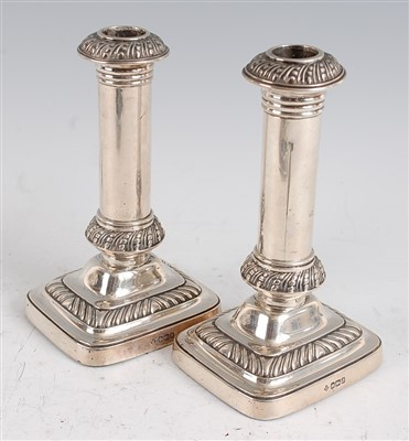 Lot 1114 - A pair of Edwardian silver table candlesticks,...