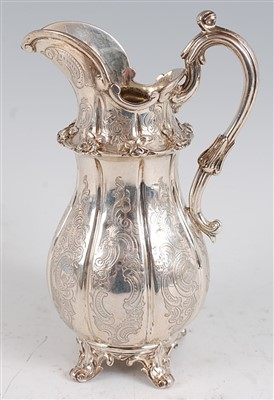 Lot 1116 - An early Victorian silver jug, of fluted...
