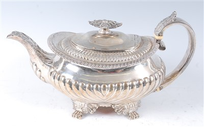 Lot 1137 - A George IV silver teapot, of squat oval form,...
