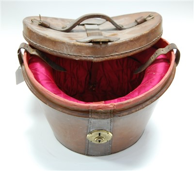 Lot 15-An Edwardian brown leather top-hat box, having...