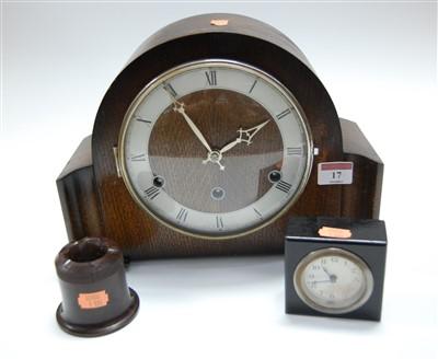Lot 17-A 1950s oak cased mantel clock, having a silvered ...
