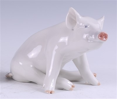 Lot 40 - A Royal Copenhagen porcelain model of a seated...