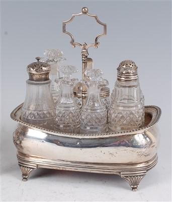 Lot 1141 - A George III silver seven bottle cruet stand,...
