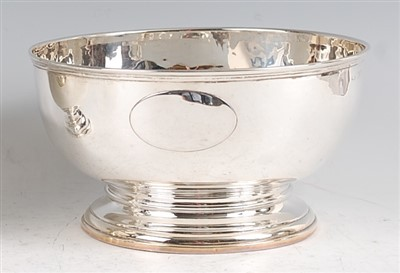 Lot 1165 - An Edwardian silver punch bowl, raised on...