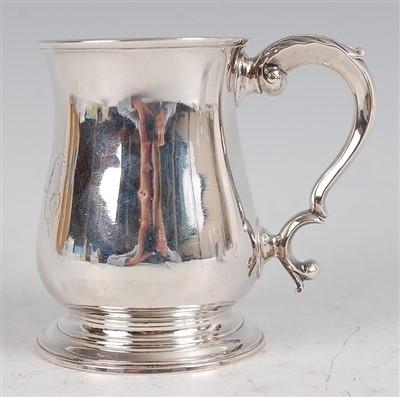 Lot 1096 - A George II silver bell shaped tankard, having...