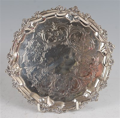 Lot 1106 - A mid-Victorian silver card waiter, having a...