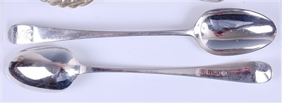 Lot 1109 - A pair of George III silver basting spoons,...