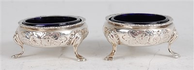 Lot 1104 - A pair of early George III silver table salts,...