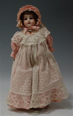 Lot 2001-A Heinrich Handwerck bisque head doll, having...