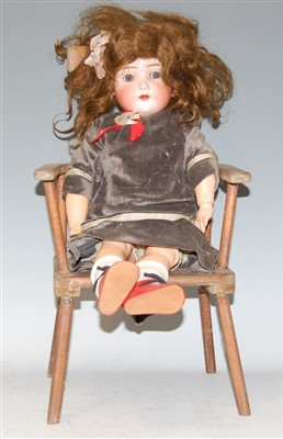 Lot 2005-A Bruno Schmidt German bisque head doll, having...
