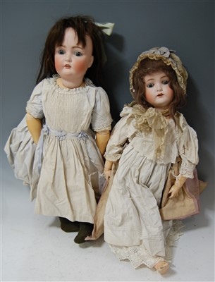 Lot 2024-A large German bisque head doll, having rolling...