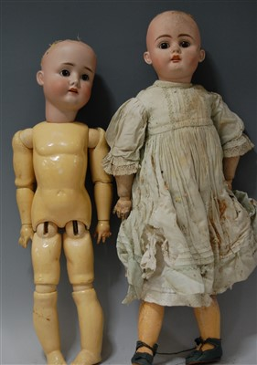 Lot 2026-A German bisque head doll, having rolling brown...