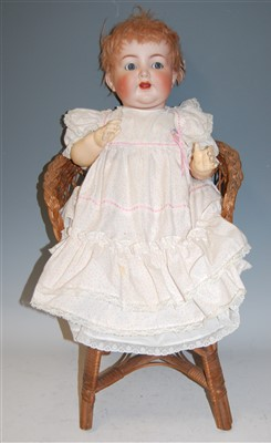 Lot 2041-A Simon & Halbig bisque head doll, having rolling ...
