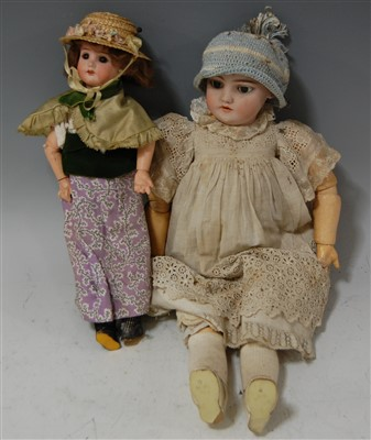 Lot 2044-A Simon & Halbig bisque head doll, having fixed...