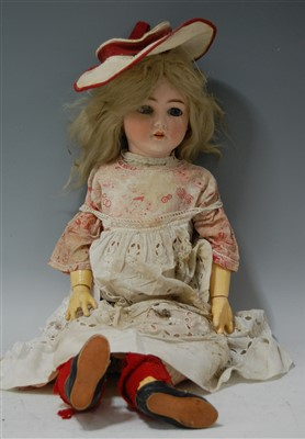 Lot 2048-A Simon & Halbig bisque head doll, having rolling ...