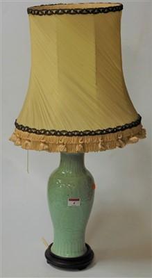 Lot 4-A Chinese celadon glazed vase of baluster form...