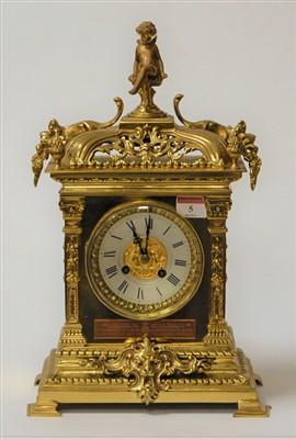 Lot 5-A brass mantel clock having applied cast...