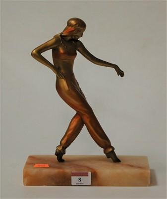 Lot 8-An Art Deco gilt metal dancing figure on...