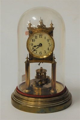 Lot 17-A lacquered brass anniversary clock under glass...