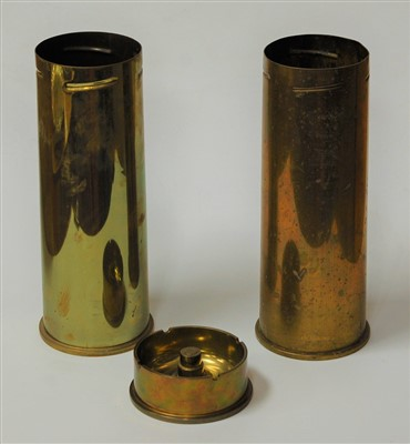 Lot 21-A pair of trench art brass cannon shell vases,...
