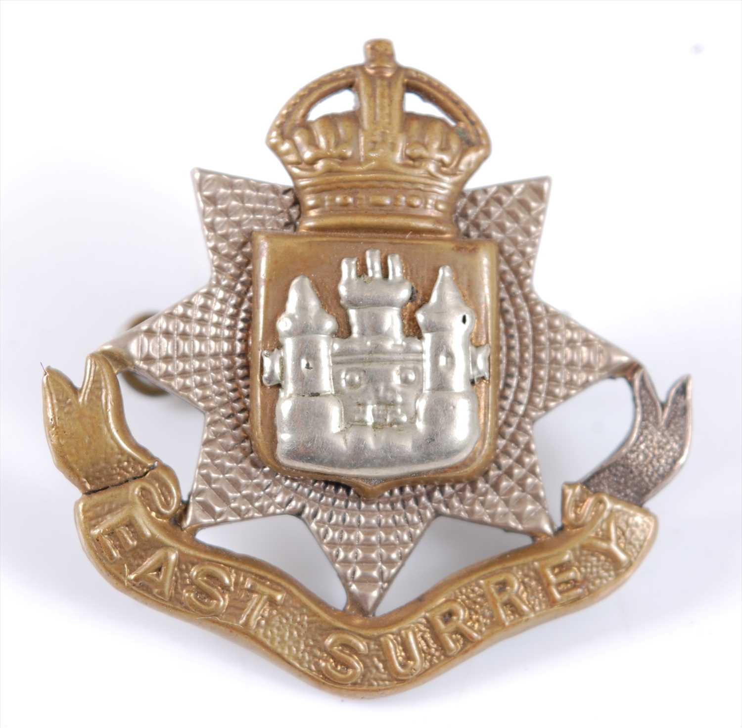 Lot 25 - An East Surrey Regiment Officer's white metal and gilt cap badge