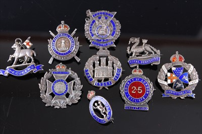 Lot 28-A collection of nine silver and enamelled sweetheart badges to include