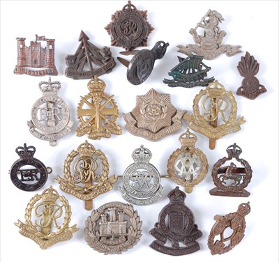 Lot 29-A collection of cap badges and insignia to include