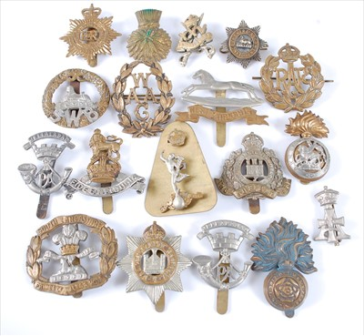 Lot 30-A collection of cap badges and insignia to include