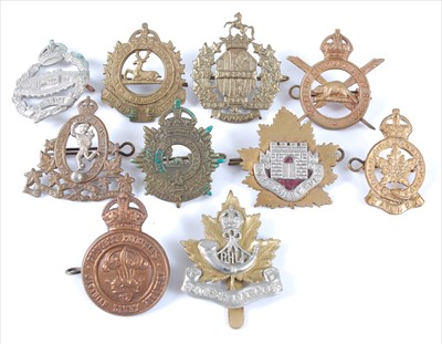 Lot 31-A collection of Canadian Regiment cap badges to include