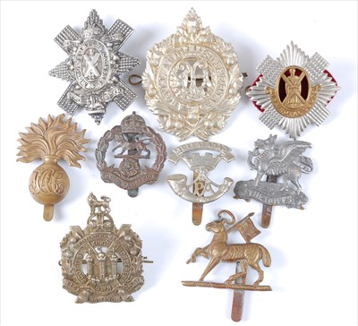 Lot 32-A collection of cap badges and insignia to include
