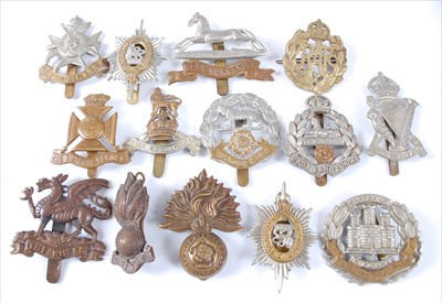 Lot 33-A large collection of cap badges and insignia to include