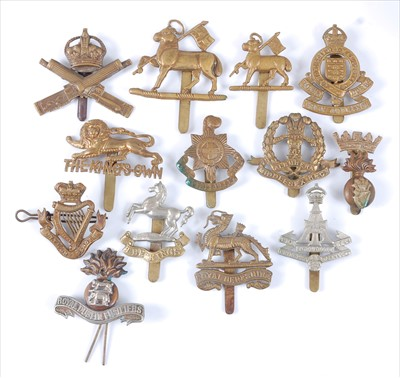 Lot 34-A collection of cap badges and insignia to include