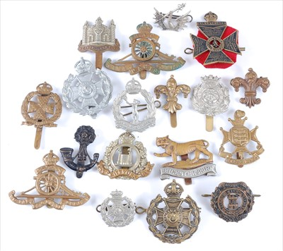 Lot 35-A collection of cap badges and insignia to include