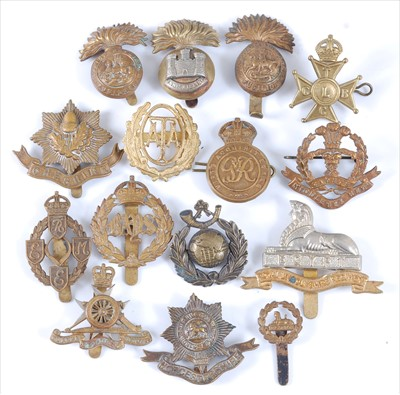 Lot 36-A collection of cap badges and insignia to include