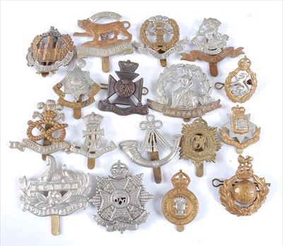 Lot 37-A collection of cap badges and insignia to include