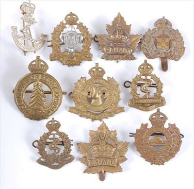 Lot 38-A collection of cap badges and insignia mainly Canadian Regiments to include