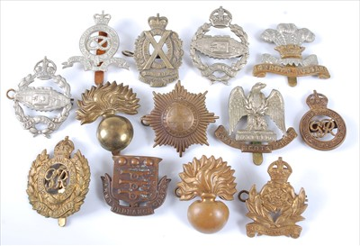 Lot 39-A collection of cap badges and insignia to include