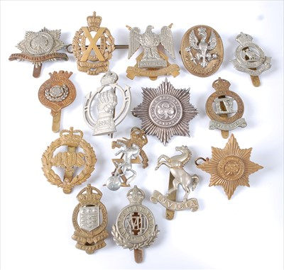 Lot 40-A collection of cap badges and insignia to include
