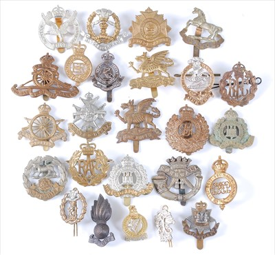 Lot 42-A collection of cap badges, cloth badges and buttons to include
