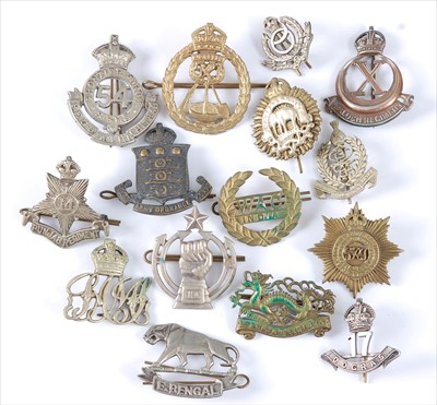 Lot 43-A collection of mainly Indian/Nepalese Regiment cap badges and insignia to include