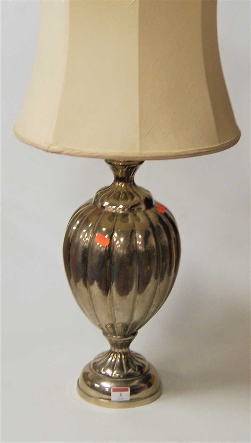 Lot 3-A modern chromed table lamp of melon form to...