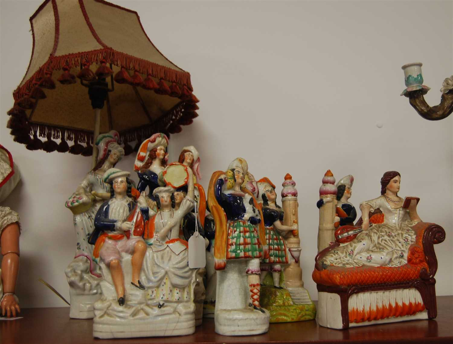 Lot 11-A Victorian Staffordshire figure of a...
