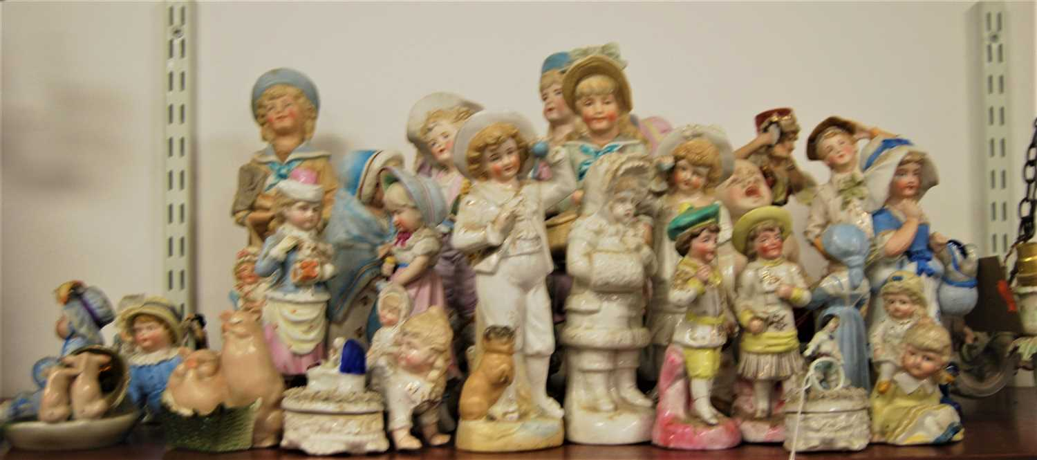 Lot 13-A late 19th century bisque porcelain figure of a...