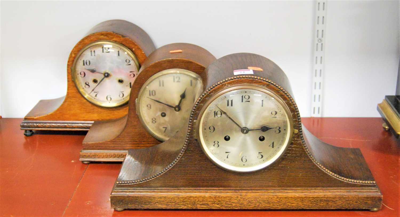 Lot 24-A 1930s oak cased mantel clock having a silvered...