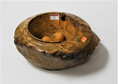 Lot 37-A sycamore mortar and various ornamental eggs