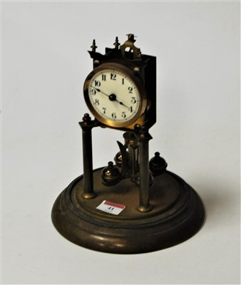 Lot 41-An early 20th century brass anniversary clock...