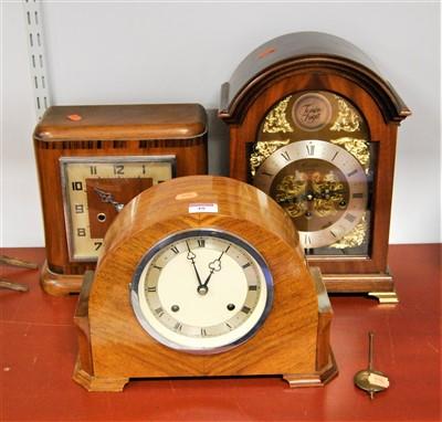 Lot 48-A 1940s walnut cased mantel clock having a...