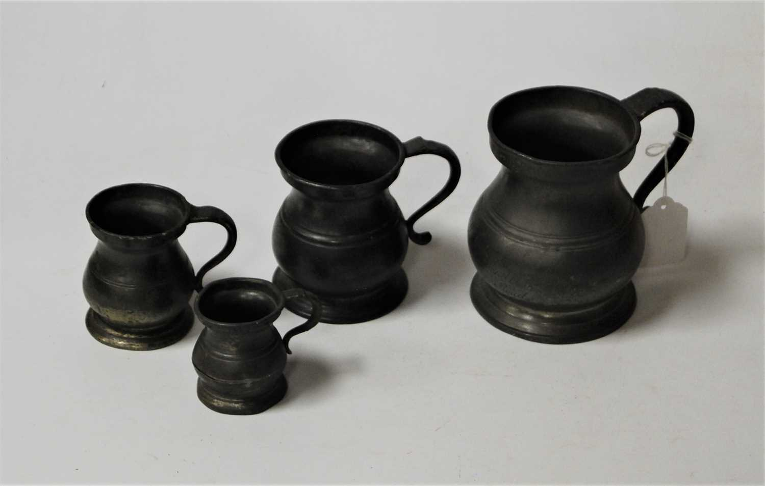 Lot 36-An 18th century pewter pint tankard with...
